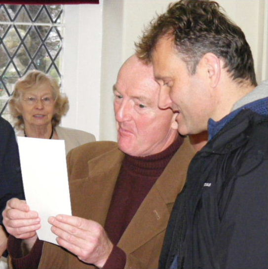Oz Clark & Hugh Dennis read the judging criteria for the sloe gin competition at the Christmas Fayre, 6th December 2009