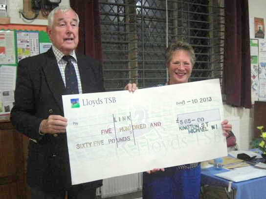 KSM WI President Jenny Hayne presents a cheque to Village Link's Chairman, Brian Goodson